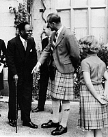 0126684 © Granger - Historical Picture ArchivePRINCE PHILIP (1921- ).   Duke of Edinburgh. Prince Philip joking with Kwame Nkrumah, Prime Minister of Ghana, about his walking stick, at Balmoral Castle in Scotland. Princess Anne looks on. Photograph, 1959.
