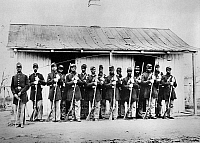 0130285 © Granger - Historical Picture ArchiveCIVIL WAR: BLACK TROOPS.   Guard House and African American guards of the 107th U.S. Colored Infantry Regiment at Fort Corcoran, Arlington, Virginia, during the American Civil War.