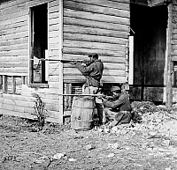 0163362 © Granger - Historical Picture ArchiveCIVIL WAR: UNION SOLDIERS.   African American troops firing rifles at the picket station near Dutch Gap Canal in Dutch Cap, Virginia. Photograph, November 1864.