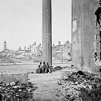 0259352 © Granger - Historical Picture ArchiveCIVIL WAR: CHARLESTON, 1865.   Children sitting near ruined buildings and the porch of the Circular Church in Charleston, South Carolina, April 1865. Photographed by George N. Barnard.