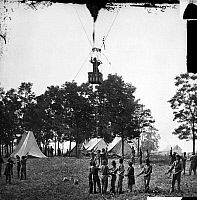 0029233 © Granger - Historical Picture ArchiveCIVIL WAR: BALLOON, 1862.   Professor Thaddeus Sobieski Coulincourt Lowe behind Union lines observing the Battle of Fair Oaks, Virginia, from his balloon 'Intrepid,' 31 May 1862.