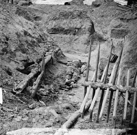 0409110 © Granger - Historical Picture ArchiveCIVIL WAR: TRENCH, 1865.   Dead Confederate soldier in a trench beyond a section of chevaux-de-frise during the siege of Petersburg, Virginia. Photograph, 1865.