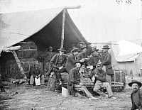 0409222 © Granger - Historical Picture ArchiveCIVIL WAR: QUARTERMASTER.   Group of the quartermaster department of the 1st Division, 9th Corps eating and drinking in Petersburg, Virginia. Photograph, 1864.