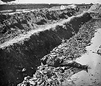 0090659 © Granger - Historical Picture ArchiveCIVIL WAR: PETERSBURG, 1865.   A dead Confederate soldier in a trench at Fort Mahone, near Petersburg, Virginia. Photograph, 3 April 1865.