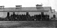 0265204 © Granger - Historical Picture ArchiveCIVIL WAR: UNION FORT.   Company K, 3rd Regiment Massachusetts Volunteer Heavy Artillery, at Fort Stevens, Washington, D.C., shortly after the American Civil War. Photographed by William Morris Smith, August 1865.