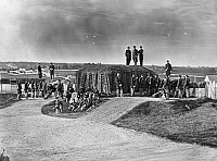 0265207 © Granger - Historical Picture ArchiveCIVIL WAR: UNION FORT.   Detachment of Company K, 3rd Regiment Massachusetts Volunteer Heavy Artillery, manning the guns at Fort Stevens, Washington, D.C., shortly after the American Civil War. Photographed by William Morris Smith, August 1865.