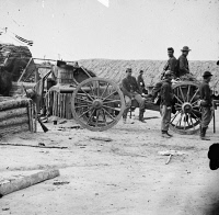 0409114 © Granger - Historical Picture ArchiveCIVIL WAR: REMOVAL, 1865.   Union soldiers removing artillery from Confederate fortifications, Petersburg, Virginia. Photograph, 1865.