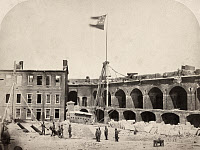 0419834 © Granger - Historical Picture ArchiveCIVIL WAR: FORT SUMTER, 1861.   Confederate flag flying over Fort Sumter after the surrender of Major Anderson and the Union Army, Charleston, South Carolina. Photograph, April 1861.