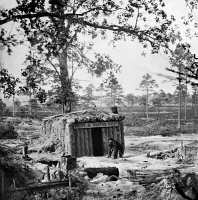 0130156 © Granger - Historical Picture ArchiveCIVIL WAR: RESTAURANT.   Business seems to be slow at Sutlers' bomb proof 'Fruit & Oyster House' on the Union Army line at the siege of Petersburg, Virginia, June 1864 to March 1864. Photograph by Timothy H. O'Sullivan.