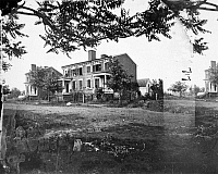 0053152 © Granger - Historical Picture ArchiveCIVIL WAR: FREDERICKSBURG.   Houses damaged in Fredericksburg, Virginia, by shelling during the American Civil War, 13 December 1862. Photographed May 1864.