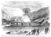 0355192 © Granger - Historical Picture ArchiveCIVIL WAR: HARPER'S FERRY.   Destruction of the railroad bridge over the Potomac, at Harper's Ferry, Virginia, by Confederate forces on 15 June 1861. Contemporary American wood engraving.