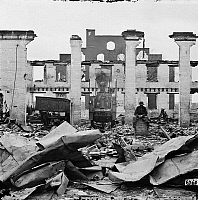 0163370 © Granger - Historical Picture ArchiveCIVIL WAR: RICHMOND, 1865.   An African American man sitting amongst the ruins of Richmond and Petersburg Railroad depot in the burned district of Richmond, Virginia following the American Civil War. Photograph, April 1865.