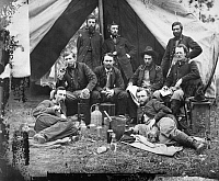0090624 © Granger - Historical Picture ArchiveCIVIL WAR: CUSTER, 1862.   The staff of General Fitz-John Porter; reclining: Lieutenants William G. Jones and George A. Custer, at the Peninsula, Virginia, 20 May 1862. Photographed by James F. Gibson.
