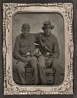 0264549 © Granger - Historical Picture ArchiveCIVIL WAR: SOLDIER, c1865.   Portrait of African American soldiers in Union uniforms. Tintype, c1865.