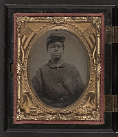 0264551 © Granger - Historical Picture ArchiveCIVIL WAR: SOLDIER, c1865.   Portrait of an African American soldier in a Union uniform. Tintype, c1865.