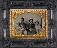 0264992 © Granger - Historical Picture ArchiveCIVIL WAR: FAMILY, c1864.   Portrait of a Union soldier with his wife and daughters. Ambrotype, c1864.