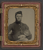 0265004 © Granger - Historical Picture ArchiveCIVIL WAR: SOLDIER, c1863.   Portrait of a Union Army soldier wearing a corporal's uniform and holding a kepi of Company B, 15th New Hampshire Volunteers. Ambrotype, c1863.
