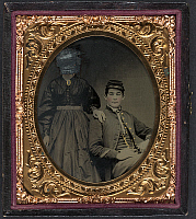 0266711 © Granger - Historical Picture ArchiveCIVIL WAR: COUPLE, c1863.   Portrait of a Union Army soldier and a woman whose face has been scratched out. Tintype, c1863.