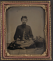 0268945 © Granger - Historical Picture ArchiveCIVIL WAR: SOLDIER, c1863.   Portrait of an unidentified Union soldier posing with his mess kit. Tintype, c1863.