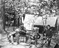 0004324 © Granger - Historical Picture ArchiveCIVIL WAR SOLDIERS.   Charles Francis Adams, Jr. (hatless), a future historian, takes part in history with fellow officers of 1st Massachusetts Cavalry at the Army of Potomac Headquarters before the fall of Petersburg. Photographed in August of 1864, by Timothy O'Sullivan.