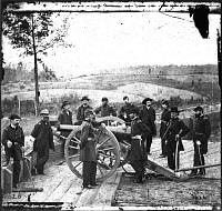 0031955 © Granger - Historical Picture ArchiveWILLIAM TECUMSEH SHERMAN   (1820-1891). American army commander. General Sherman (right center, with his arm on the cannon's breach) with his staff at Federal Fort No. 7, Atlanta, in the autumn of 1864. Photograph by George N. Barnard.