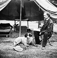 0163164 © Granger - Historical Picture ArchiveCIVIL WAR: CUSTER, 1862.   Lieutenant George A. Custer with a dog at camp in Virginia, 1862.
