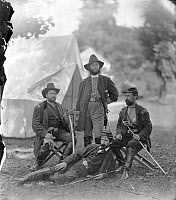 0409214 © Granger - Historical Picture ArchiveCIVIL WAR: UNION OFFICERS.   Col. James H. Childs (standing) with other officers of the 4th Pennsylvania Cavalry in Westover Landing, Virginia. Photograph by Alexander Gardner, August 1862.