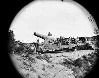 0163163 © Granger - Historical Picture ArchiveCIVIL WAR: FORT FISHER, 1865.   Union army soldiers with a cannon after the capture of the Confederate Fort Fisher in North Carolina. Photograph by Timothy O'Sullivan, January 1865.