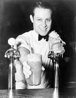 0407854 © Granger - Historical Picture ArchiveSODA JERK, 1936.   A soda jerk with an ice cream soda. Photograph by Alan Fisher, 1936.