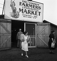 0122991 © Granger - Historical Picture ArchiveFARMER'S MARKET, 1940.   Customers at the entrance of the Tri-County Farmers Co-op Market in Du Bois, Pennsylvania. Photograph by Jack Delano, August 1940.