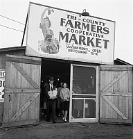 0122992 © Granger - Historical Picture ArchiveFARMER'S MARKET, 1940.   Customers at the entrance of the Tri-County Farmers Co-op Market in Du Bois, Pennsylvania. Photograph by Jack Delano, August 1940.