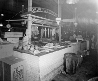 0350663 © Granger - Historical Picture ArchiveFISH MARKET, c1916.   C.H. Javins and Sons fish and poultry stand. Photograph, c1916.