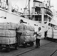 0259199 © Granger - Historical Picture ArchiveFINLAND: SHIPPING, 1958.   Women checking cargo in the port of Oulu in Finland. Photograph, 1958.