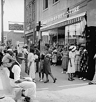 0123104 © Granger - Historical Picture ArchiveMAIN STREET SHOPPERS, 1939.   African American men and women shopping and socializing on Main Street during a Saturday afternoon in Pittsboro, North Carolina. Photograph by Dorothea Lange, July 1939.