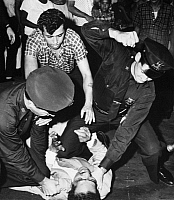 0092996 © Granger - Historical Picture ArchiveNYC: STREET FIGHT, 1961.   Policemen subdue a man among a group involved in a street fight in Brooklyn, 1961.