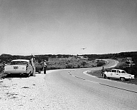0093388 © Granger - Historical Picture ArchiveTEXAS RANGERS, 1967.   Texas Rangers and Highway Patrolmen man a road-block during a hunt for a wanted felon, 1967.