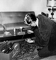 0093400 © Granger - Historical Picture ArchiveWIRETAPPING.   A man installing an electronic listening device in a home.