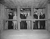 0216693 © Granger - Historical Picture ArchivePOLICE: TARGET RANGE, 1940.   Officers R.P. Hallion, E.L. Warden, and J.J. Cash of the White House Police (left to right) practice shooting in a newly installed target range in the sub-basement of the Treasury Building in Washington, D.C., 10 June 1940. At center, wearing suit, is Frank J. Wilson, Chief of the U.S. Secret Service.