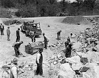 0118947 © Granger - Historical Picture ArchivePRISONERS.   African American convicts breaking up rocks for road construction at a prison camp in rural America. Photograph, c1934-1950.