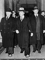 0167042 © Granger - Historical Picture ArchiveLOUIS 'LEPKE' BUCHALTER  (1897-1944). American mobster and head of the hit squad Murder Inc. Pictured at center handcuffed to F.B.I. Director J. Edgar Hoover, entering a courthouse, 1940.