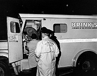 0093376 © Granger - Historical Picture ArchiveBOSTON: ROBBERY, 1968.   Boston Police detectives dust for fingerprints and examine a Brinks Armored car for clues after it was robbed of an estimated half-million dollars, 1968.