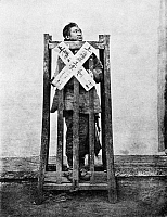 0121155 © Granger - Historical Picture ArchiveCHINA: PUNISHMENT, c1870.   A criminal in China being punished by confinement in a cage, in which he can relieve his feet only by suspending himself by the neck, and will ultimately die of starvation and thirst. Photographed by John Thomson, c1870.