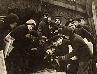 0125810 © Granger - Historical Picture ArchiveBOYS SHOOTING CRAPS, c1910.   Group of boys newsboys gambling with dice in the paper alley in Rochester, New York. Photograph by Lewis Hine, c1910.