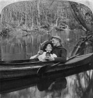 0326169 © Granger - Historical Picture ArchiveLOVE: COUPLE ROWING, 1897.   'Going with the Stream.' Stereograph, 1897.