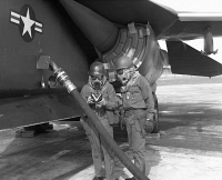 0268393 © Granger - Historical Picture ArchiveFALLOUT DRILL, 1978.   Crewmen of the 48th Organizational Maintenance Squadron consulting a manual while refueling an F-111 aircraft during a fallout drill. Photograph, 22 September 1978.