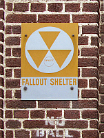0268343 © Granger - Historical Picture ArchiveSIGN: FALLOUT SHELTER.   Signs for a fallout shelter on an apartment building in Brooklyn, New York. The fallout shelter sign was introduced by the United States Department of Defense Office of Civil Defense in the 1960s to designate federally approved shelters. Photograph by Sarah Steele, 2012.