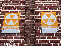0268344 © Granger - Historical Picture ArchiveSIGN: FALLOUT SHELTER.   Signs for a fallout shelter on an apartment building in Brooklyn, New York. The fallout shelter sign was introduced by the United States Department of Defense Office of Civil Defense in the 1960s to designate federally approved shelters. Photograph by Sarah Steele, 2012.