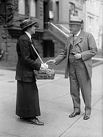 0106774 © Granger - Historical Picture ArchiveFLOWER PEDDLER, 1915.   Mrs. Ormsby selling flowers for charity before Metropolis Club, 1915.