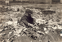 0107066 © Granger - Historical Picture ArchiveBOY PLAYING IN DUMP, 1916.   Pleasant Street Dump, Fall River, Massachusetts. Photographed on 21 June 1916 by Lewis Hine.