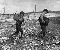 0107067 © Granger - Historical Picture ArchiveDUMP SCAVENGERS, 1916.   Two boys seen scavengering at Pine Street Dump, Fall River, Massachusetts. Photographed on 22 June 1916 by Lewis Hine.